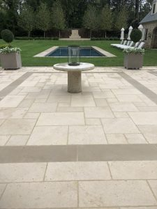 "French limestone hardscape featuring ""Clair"""