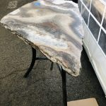 Lovely petite onyx table, triangle shaped
