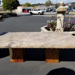 Travertine table with hammered edge, wooden block legs