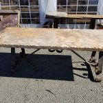 "Travertine table, 7' x 36"" with wrought iron base"