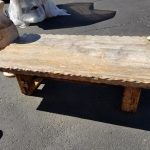 Travertine coffee table with hammered edge, wood base shown here, also available with wrought iron base